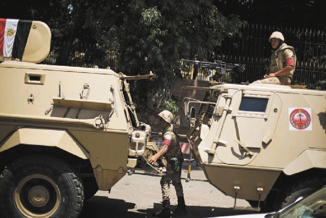 Egyptian soldiers deploy near Cairo University, where of Muslim Brotherhood supporters have gathered to support ousted president Mohammed Morsi in Cairo, Thursday. The chief justice of Egypt's Sup ...