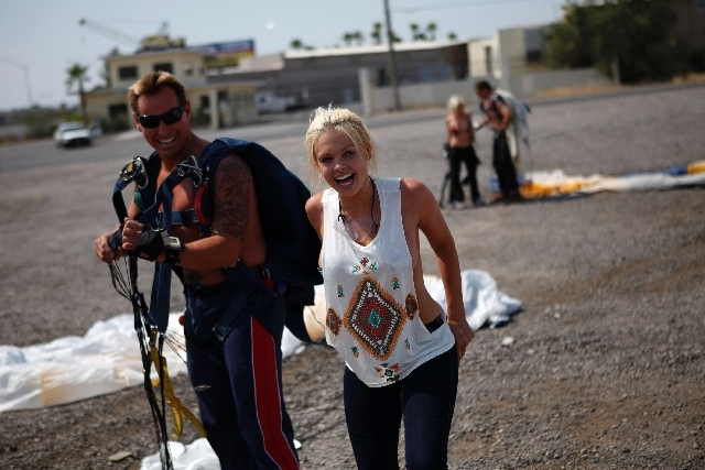 "Porn star Jesse Jane smiles after doing a sky dive with J.C. Ledbetter, left, during the ""Flight of the Tatas"" event at Larry Flynt's Hustler Club in Las Vegas on Thursday."