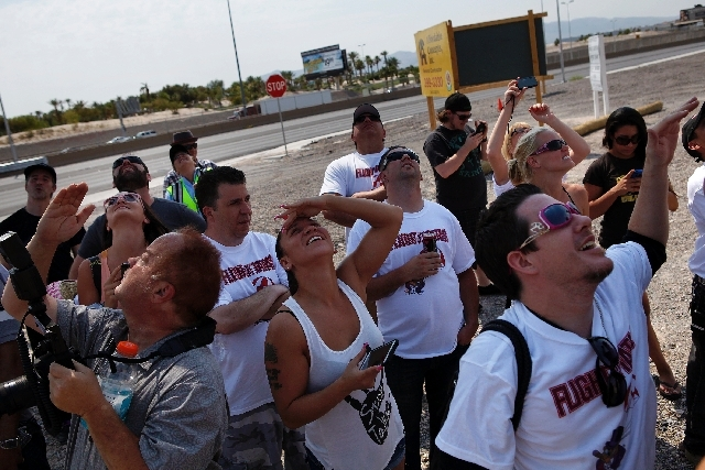 "Spectators watch sky divers during the ""Flight of the Tatas"" event at Larry Flynt's Hustler Club in Las Vegas on Thursday."