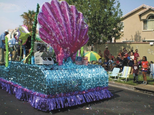 A bubble machine spews bubbles into the air Thursday during the 19th Annual Summerlin Council Patriotic Parade.
