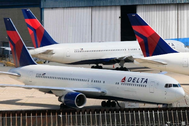 Delta Air Lines jets are parked at John F. Kennedy International Airport, in New York.