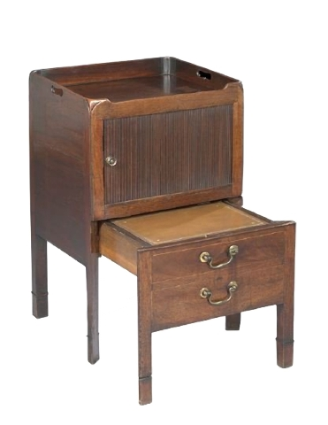 """This George III mahogany piece is a commode, not a table. It was made in the 18th century to hold the necessary nighttime """"toilet"""" equipment behind tambour doors. It sold for $950 at a New Orleans ..."""