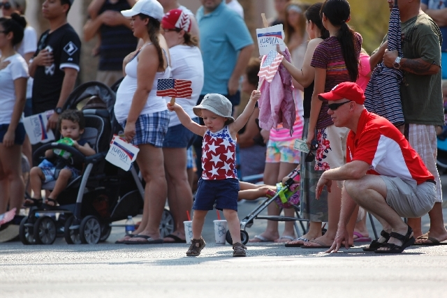 A child dances around during the 19th Annual Summerlin Council Patriotic Parade on Thursday.
