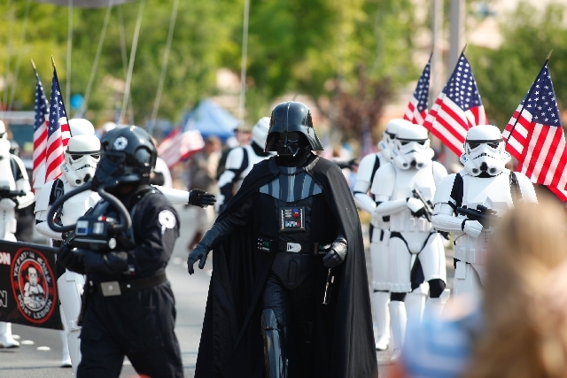 """Darth Vader and stormtroopers from """"Star Wars,"""" representing the Neon City Garrison, march during the 19th Annual Summerlin Council Patriotic Parade on Thursday."""