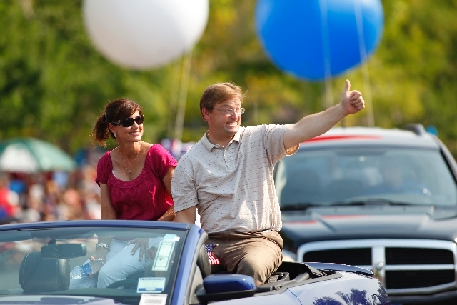 U.S. Sen. Dean Heller, R-Nev., waves to the crowd during the 19th Annual Summerlin Council Patriotic Parade on Thursday.