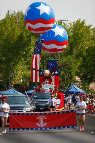 Floats keep people entertained during the 19th Annual Summerlin Council Patriotic Parade on Thursday.