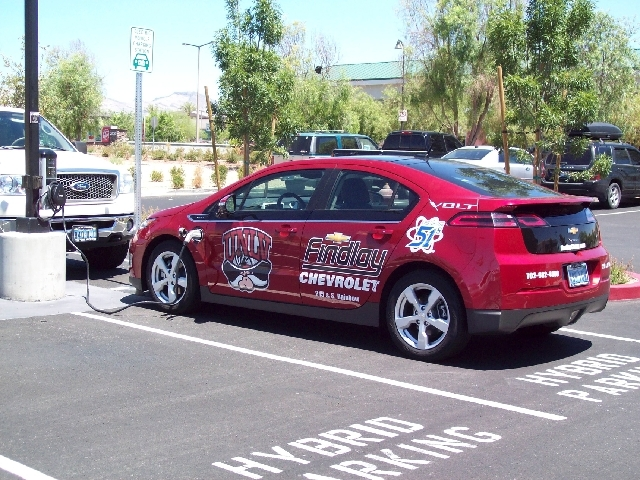 A  Level 2 charging station recharges a Chevrolet Volt battery pack while the vehicle's driver shops at Las Vegas Cyclery.