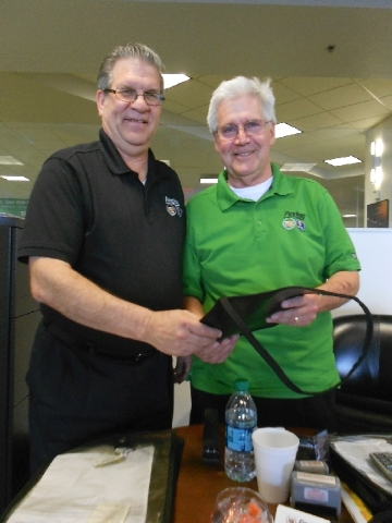 Findlay Cadillac service writers Mike Hall, left, and Keith Acree have been with Findlay Automotive Group for a combined total of 45 years.