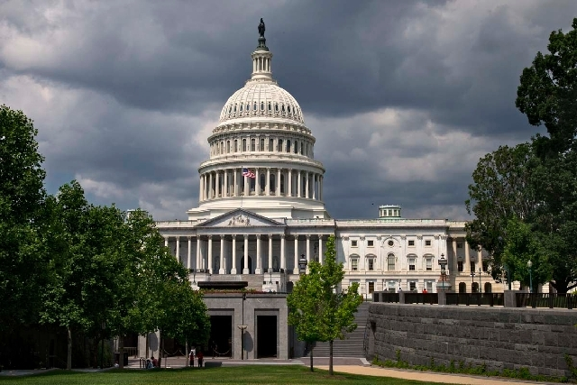 The U.S. Capitol is seen in Washington in June. Newly announced House candidate Erin Bilbray proposed Wednesday that lawmakers take a 10 percent pay cut until the federal budget is balanced.