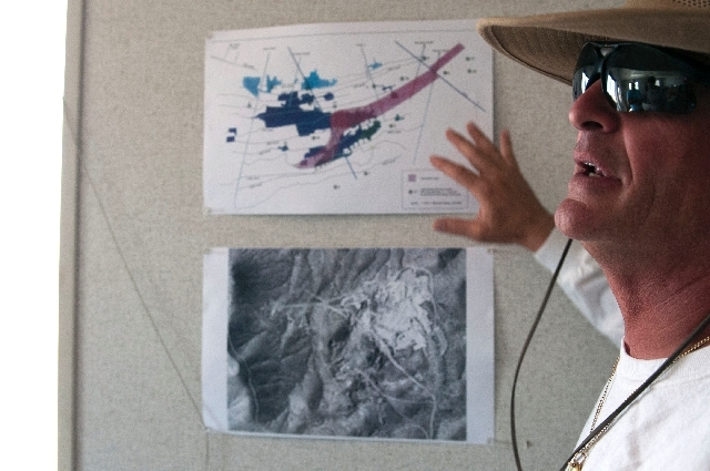 L.R. Ted Tinell, president of Quartette mine, shows maps of the mine site on Wednesday.