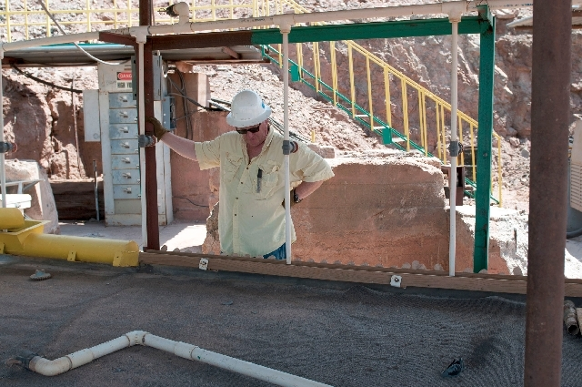 Glen Rehn, director of Quartette mine near Searchlight, Nev., inspects the physical separation mill that will be used to process gravel from the mine site on Wednesday.
