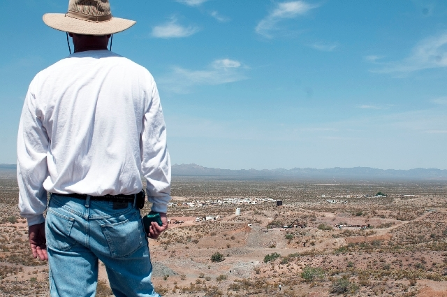 L.R. Ted Tinnell, president of Quartette mine, looks out to the mining site from the top of a hill on Wednesday near Searchlight, Nev.