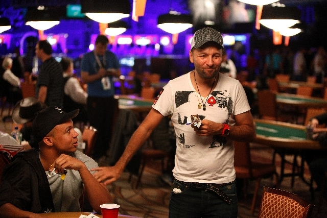 Daniel Negreanu, right, jokes with fellow poker pro Phil Ivey on Wednesday during the World Series of Poker $2,500 buy-in triple-draw lowball event at the Rio Convention Center. Negreanu reached t ...