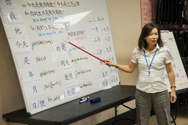 Chinese language instructor Chi Chen, right, leads a Mandarin Chinese language and culture class at the Winchester Cultural Center.