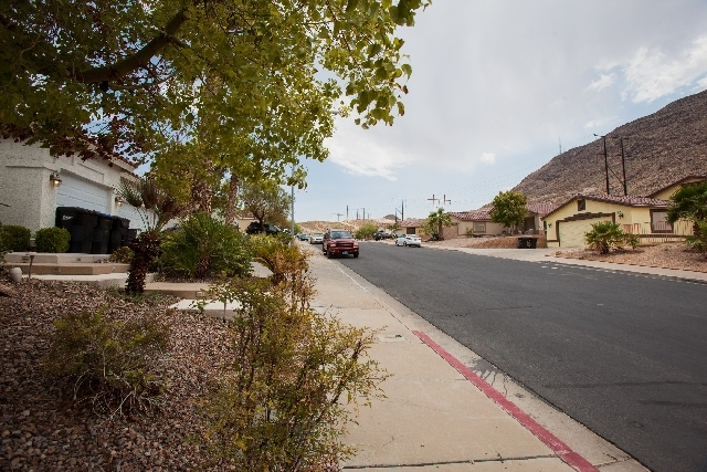 Seen on the far right is a home at 363 Eveningside Avenue in Henderson, where a Henderson SWAT team was called about a domestic violence dispute. Henderson Police are being accused of illegally br ...