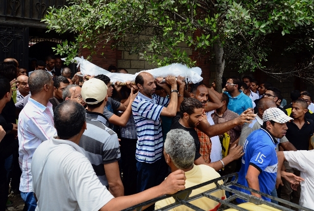 People carry a body during a funeral in Alexandria's Sidi Gaber district, Egypt on Saturday.