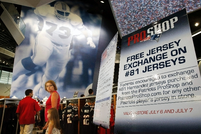 A sign inside the New England Patriots store at Gillette Stadium in Foxborough, Mass., gives information about the offer to exchange No. 81 Aaron Hernandez jerseys for those of another player on t ...