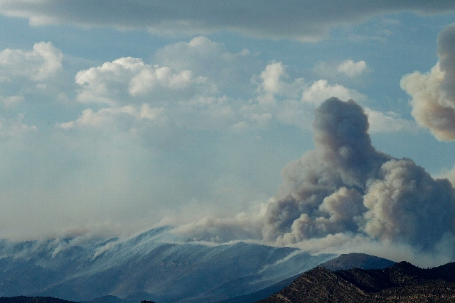 A plume of smoke rises into the atmosphere from the Carpenter 1 Fire outside of Pahrump on July 5.