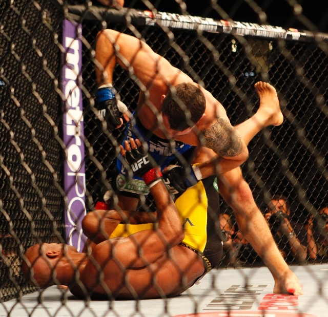 Chris Weidman pummels the prone Anderson Silva during the second round of their UFC 162 middleweight title fight Saturday at the MGM Grand Garden. Weidman won by knockout, handing Silva his first  ...