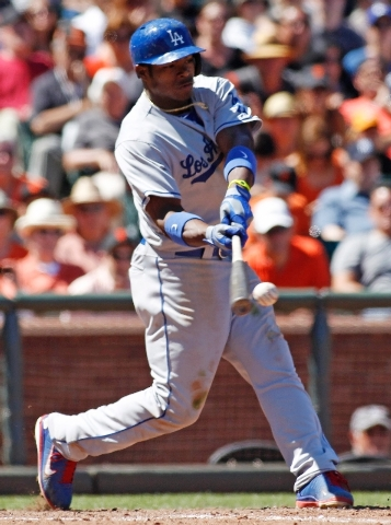 Los Angeles Dodgers' Yasiel Puig hits a single against the San Francisco Giants during the ninth inning of a baseball game in San Francisco, Sunday, July 7. The Dodgers beat the Giants 4-1.