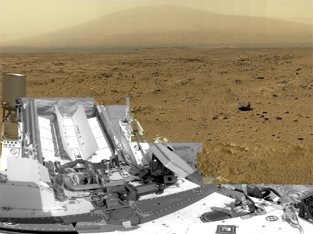 This photo released by NASA shows a photo stitched together from nearly 900 images taken by the NASA rover Curiosity showing a section of Gale Crater near the Martian equator. Nearly a year after  ...