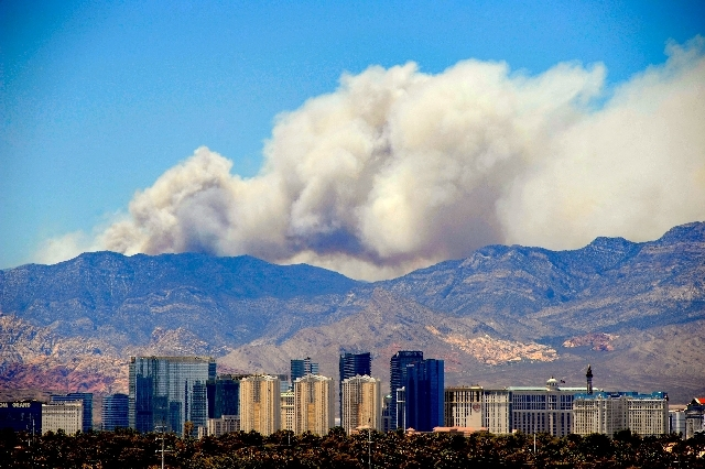 Smoke continues to billow from the ongoing Carpenter Canyon fire atop Mount Charleston as seen from east of the Las Vegas Strip on Monday. Fire crews are hoping to have the wildfire 100 percent co ...