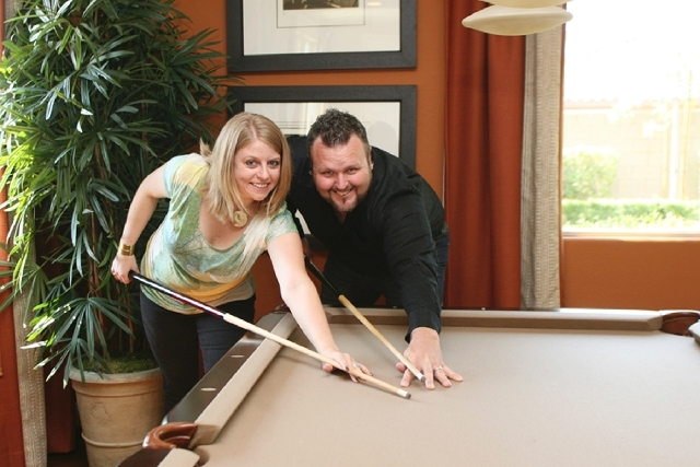Sara Even and Marcus Ross, sound engineers with major Las Vegas production shows, check out the pool table in the model of their Laramie plan at Pardee Homes' Durango Ranch neighborhood.