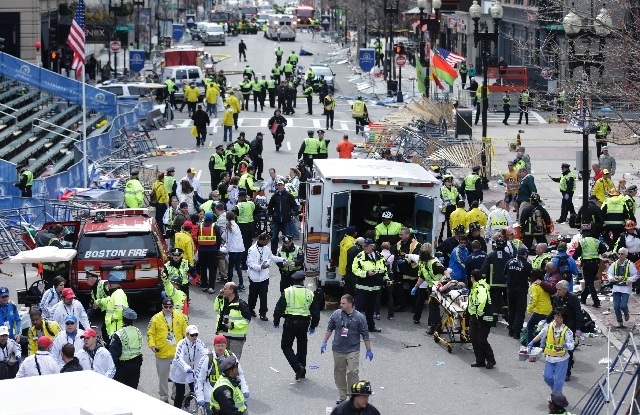 This April 15 photo shows medical workers aiding injured people at the finish line of the 2013 Boston Marathon in Boston following an explosion.