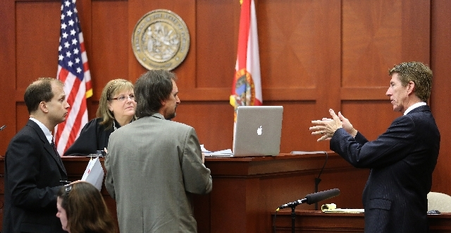 Defense counsel Mark O'Mara, far right, addresses forensics animation expert Daniel Shumaker, center, with Assistant State Attorney Richard Mantei, far left, and Judge Debra Nelson looking on Tues ...