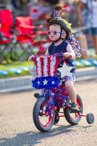 Since the parade's inception, Summerlin children have decorated their bikes in stars and stripes to lead the annual event. They now participate as the Patriotic Peddlers, helping kick off the esco ...