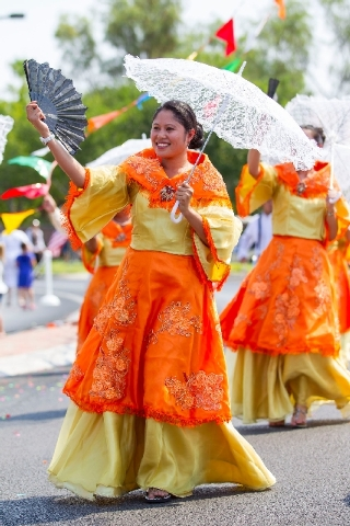 Festively dressed members of the Philippine American Association of Summerlin walk in the parade to celebrate Independence Day, which also signifies the Philippines' independence granted by Americ ...