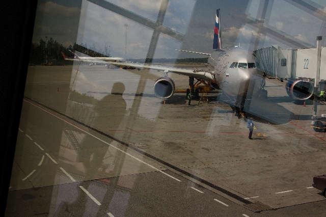 Though a window, the Aeroflot flight to Havana plane is seen parked for boarding next to a gate of Sheremetyevo airport outside Moscow, Russia, on Tuesday. NSA leaker Edward Snowden is believed to ...