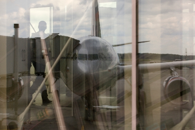 The Aeroflot flight to Havana plane reflects in a window of Sheremetyevo airport outside Moscow, Russia, on Tuesday. NSA leaker Edward Snowden is believed to be stuck in the transit zone of Moscow ...
