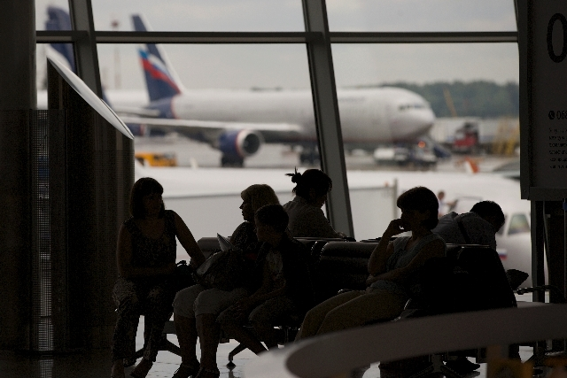 Passengers wait for their flights in Sheremetyevo airport outside Moscow, Russia, on Tuesday. NSA leaker Edward Snowden is believed to be stuck in the transit zone of Moscow's Sheremetyevo airport ...