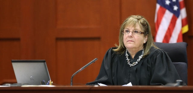 Judge Debra Nelson listens to testimony in the George Zimmerman trial in Seminole Circuit Court, in Sanford, Fla., Tuesday. Zimmerman is charged with second-degree murder in the fatal shooting of  ...