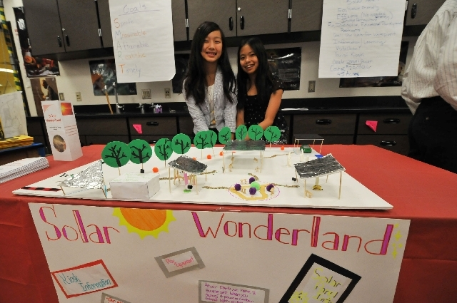 From left, Olivia Lee, 12, and Dana Oshiro, 11, show off their model of a proposed Boulder City solar park July 3 at Clark High School, 4291 W. Pennwood Ave. Some of the brightest middle school st ...
