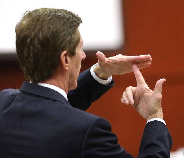 Defense counsel Mark O'Mara gestures while describing the possible angle of the gun shot that killed Trayvon Martin, during a hearing before the start of the George Zimmerman trial in Seminole CIr ...