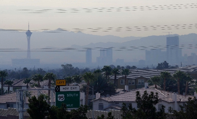 A haze, caused by the Carpenter 1 wildfire, covers the north end of the Strip as seen from the Summerlin Parkway and Durango Drive in Las Vegas Tuesday. The wildfire, which has grown to 19,000 acr ...