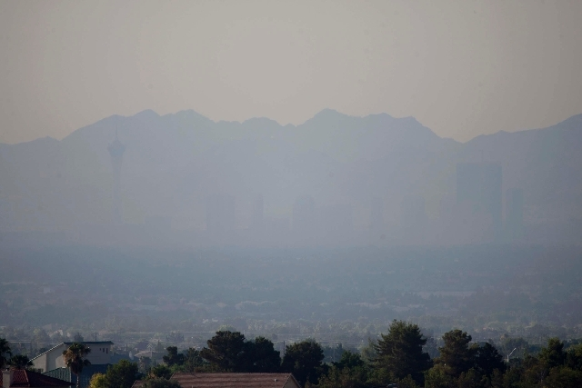 Smoke from the Carpenter 1 wildfire renders the north end of the Strip almost invisible as seen looking southeast from Lone Mountain Road and the 215 beltway in Las Vegas Tuesday. The wildfire, wh ...
