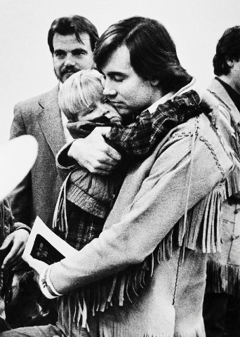 This 1988 file photo shows Addam Swapp hugging one of his sons during a court hearing in Salt Lake City.