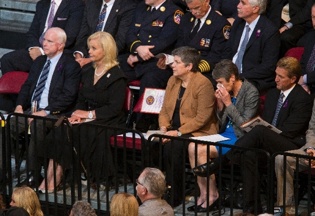 From left, Sen. John McCain, R-Ariz., Cindy McCain, Secretary of Homeland Security Janet Napolitano, Secretary of Interior Sally Jewell and Sen. Jeff Flake, R-Ariz.,  attend a memorial service for ...