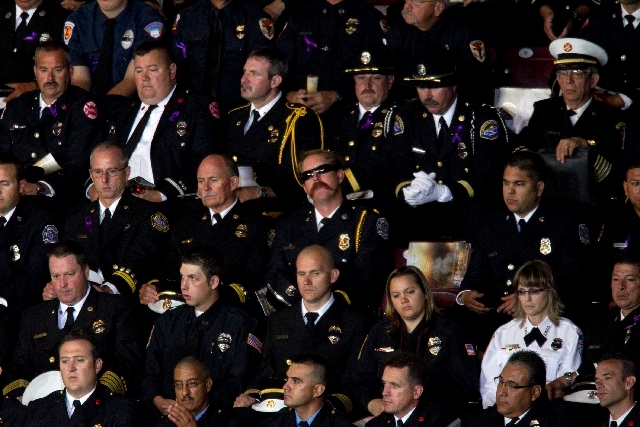 "Firefighters listen during the ""Our Fallen Brother"" memorial service for the 19 fallen firefighers at Tim's Toyota Center in Prescott Valley, Ariz. on Tuesday.   Prescott's Granite Mountain Hotsho ..."