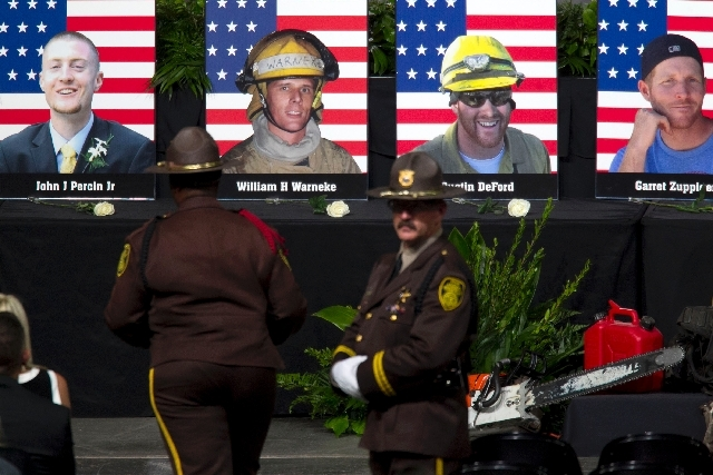 "Photographs of the 19 fallen firefighters are displayed before the ""Our Fallen Brother"" memorial service at Tim's Toyota Center in Prescott Valley, Ariz. on Tuesday.   Prescott's Granite Mountain  ..."