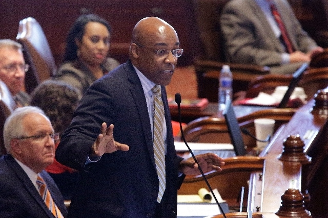 Illinois Sen. Kwame Raoul, D-Chicago, argues concealed carry gun legislation while on the Senate floor during session at the Illinois State Capitol Tuesday in Springfield, Ill.