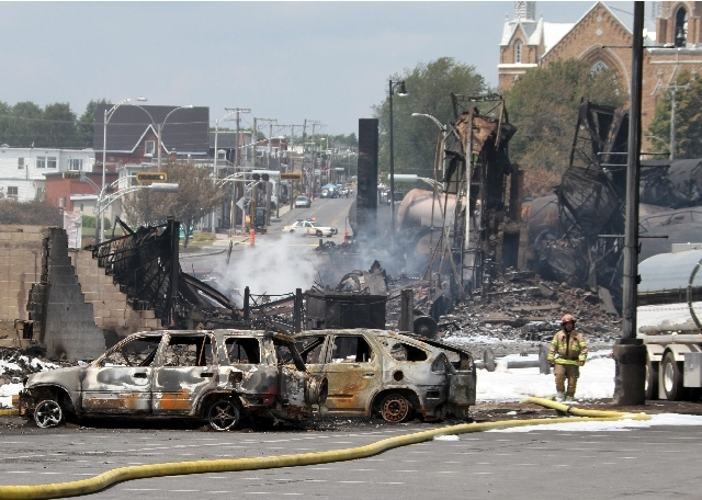 This photo provided by Surete du Quebec, shows wrecked oil tankers and debris from a runaway train on Monday in Lac-Megantic, Quebec, Canada.