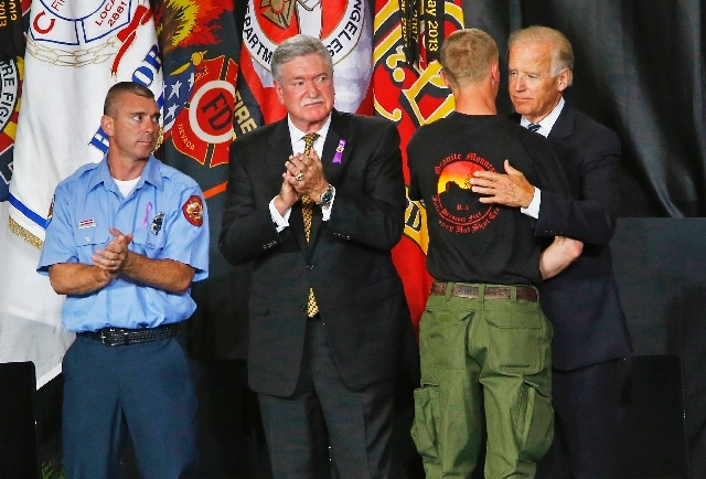 "Brendan McDonough, the only surviving member of his crew, receives a hug from Vice President Joe Biden during the ""Our Fallen Brothers"" memorial service for the 19 fallen firefighters at Tim's Toy ..."