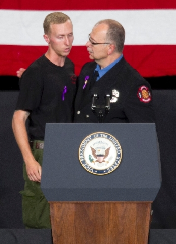 "Brendan McDonough, left, the sole surviving member of the Granite Mountain Hotshots crew hugs Tim Hill, President of the Professional Fire Fighters of Arizona before McDonough recited the ""Hotshot ..."