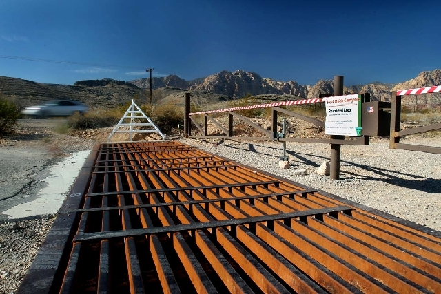 A car passes the gated road on state Route 159 that leads up to the top of Blue Diamond Hill in November 2011. Developer Jim Rhodes' plan to develop the area forced a battle over a 2003 law that s ...