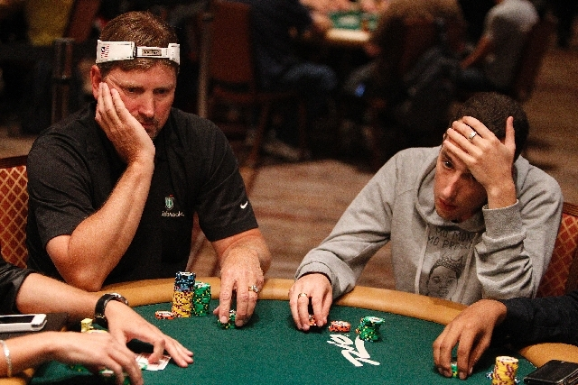 Brett Egelske, left, and Ben Ane play in the main event at the World Series of Poker at The Rio in Las Vegas Tuesday.