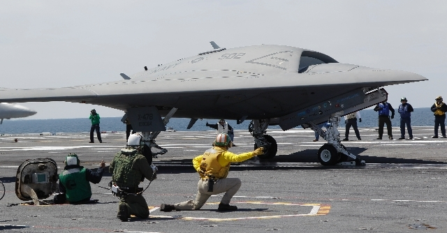 A Navy X-47B drone is launched off the nuclear powered aircraft carrier USS George H. W. Bush off the coast of Virginia, in this May 14 file photo. The Navy says the X-47B experimental aircraft wi ...